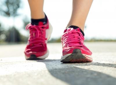 Woman's feet wearing pink running shoes